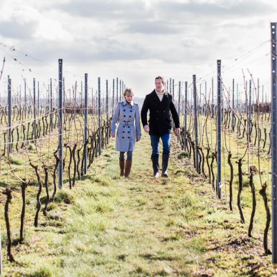 Susie Barrie MW and Peter Richards MW in the Hattingley Valley vineyard, photo by Cath Lowe photography