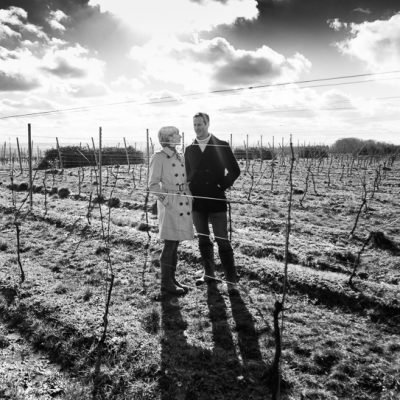 Susie and Peter in vineyard, photo credit Cath Lowe Photography